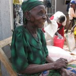 90 year old along with others getting grain for food, basically rice, maize and beans