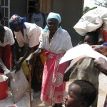 the elderly, the widows and the handicap getting help. food items such as rice, sugar, beans etc..